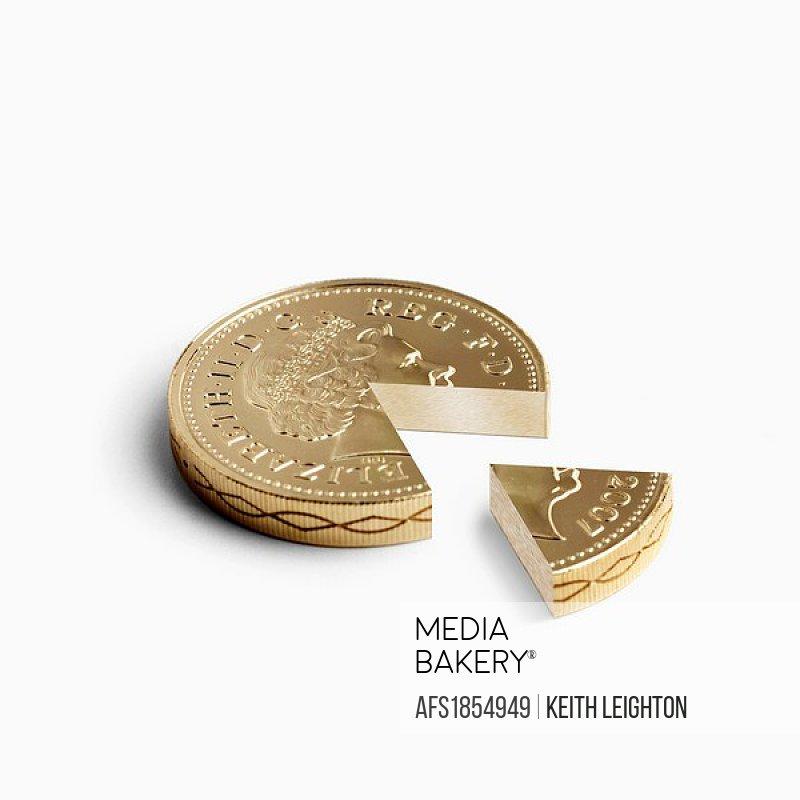 Pound coin with segment taken out