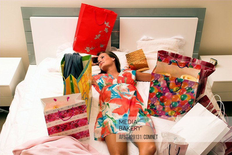 woman, Inside, home, shopping tour, tired, bed, recumbent, lie, lying, couches, tired, tired out, shopping, shopping b