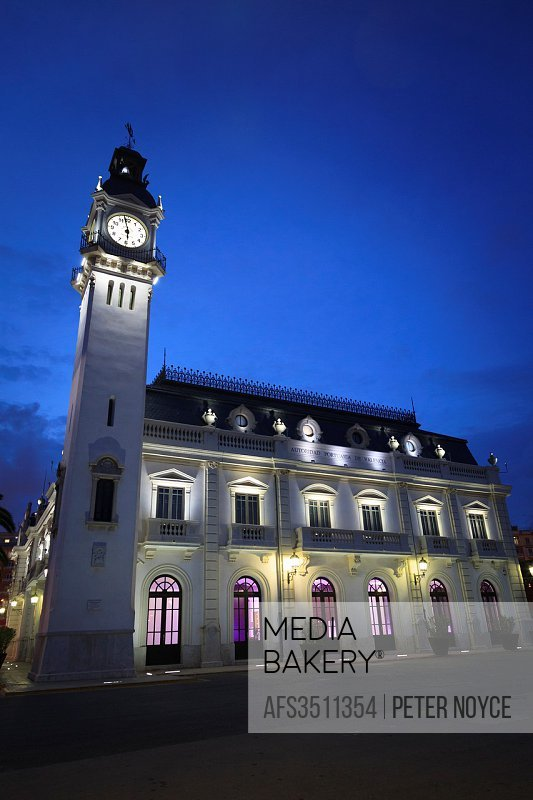 Exterior of the Port Authority of Valencia Building at dusk with it´s clock tower.