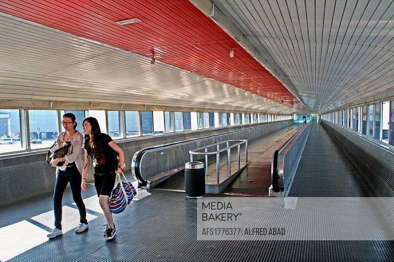 Access corridor. Terminal 2. Airport. Barcelona. Catalonia. Spain.