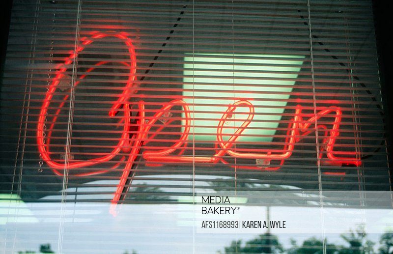 ´Open´ sign, neon, in script, in store window, Indiana, USA