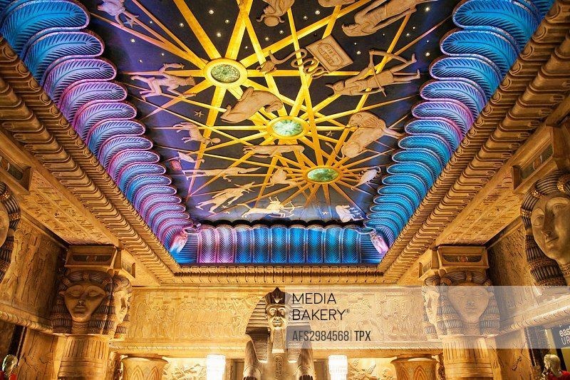 England, London, Knightsbridge, Harrods, The Egyptian Escalator, The Ceiling depicting The Night Sky with Zodiacal Figures designer William George Mit...