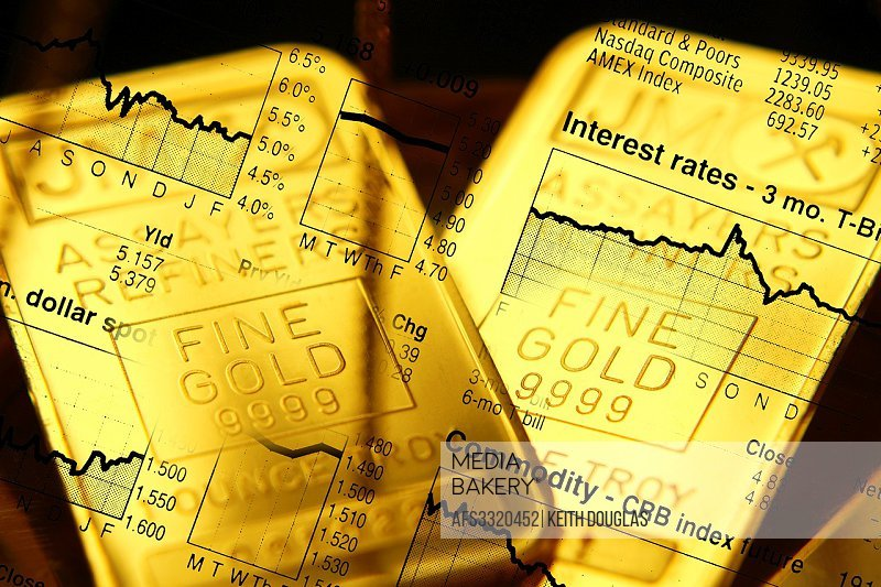 Business concept with gold bars overlaid with stock market illustration.