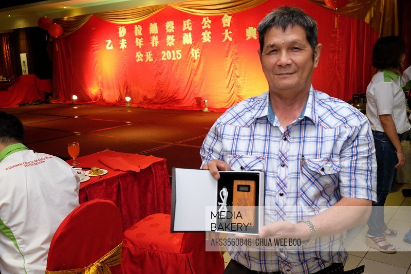 The bidder with his power bank at The Sarawak Chai´s Clan Chinese New Year Party in Kuching, Malaysia.