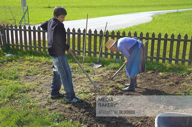 Granny and grandchild at garden work