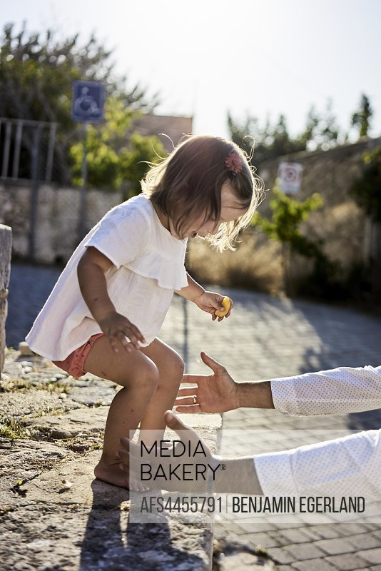 helping hands reaching for toddler daughter, outdoors, childhood, security, trust