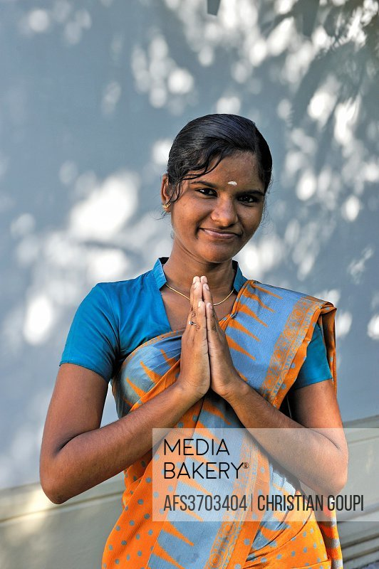 greeting by a young hostess of 5 star Heritage Madurai Hotel, Madurai, Tamil Nadu state, South India, Asia.