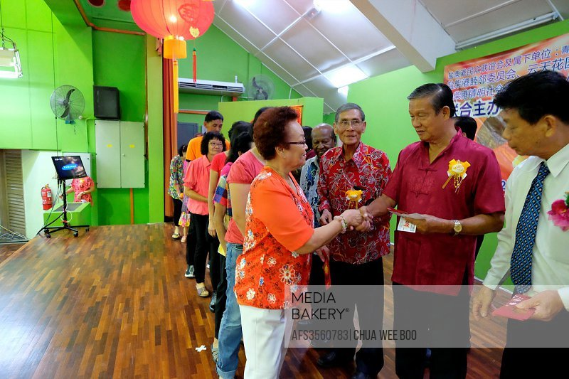 The Chinese New Year lucky draw winners receiving red packet ´ang-pow´ at Sungai Maong Community Hall, Kuching, Sarawak, Malaysia.
