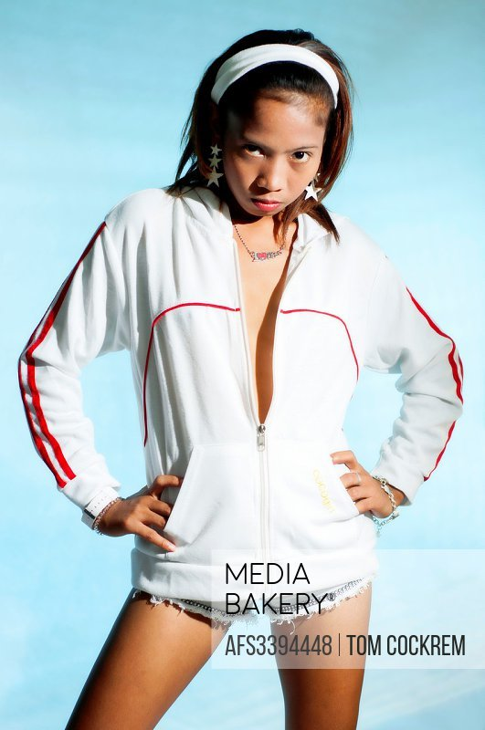 Asian character model posing in studio setting.