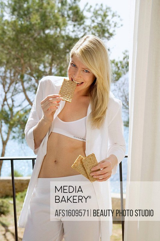 Woman healthy eating crackers