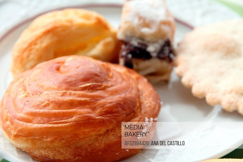 Breakfast at a terrace hotel, typical pastries from Minorca, Balearic islands, Spain