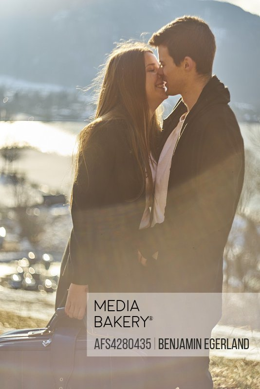 Tegernsee, Germany, couple kissing, sunny weather, winter