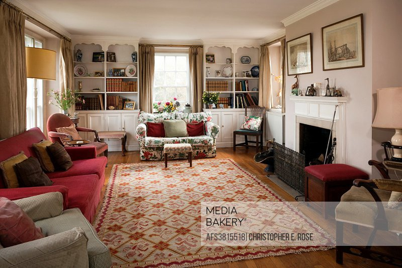 Very traditional triple aspect sitting room. Editorial Use Only.