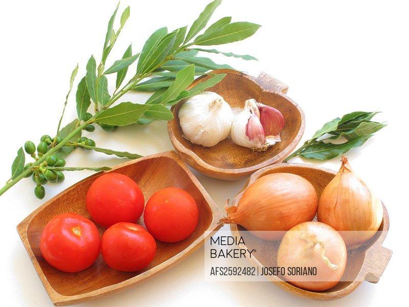 Tomato, onion, garlic and bay leaf
