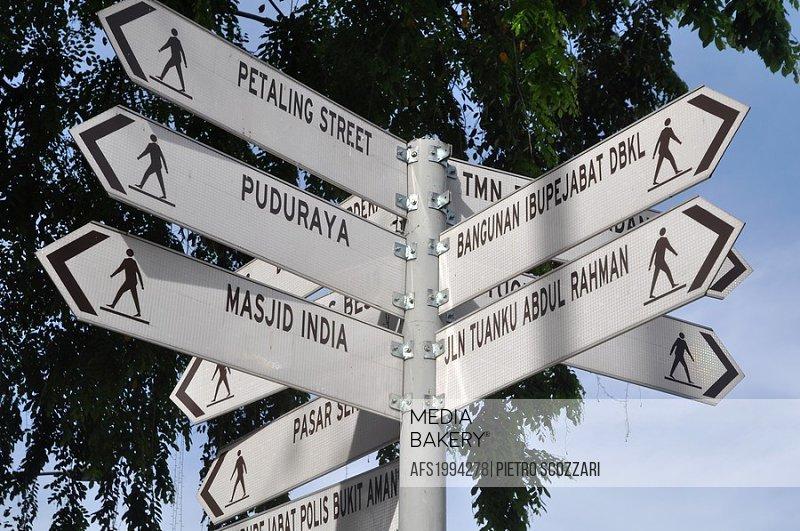 Kuala Lumpur (Malaysia): directions signs in Merdeka Square