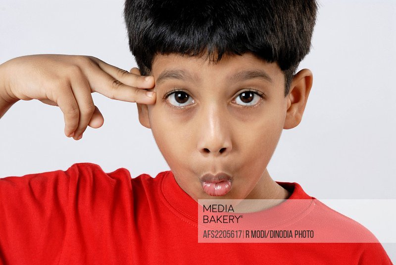 South Asian Indian boy acting like shootout , India MR152