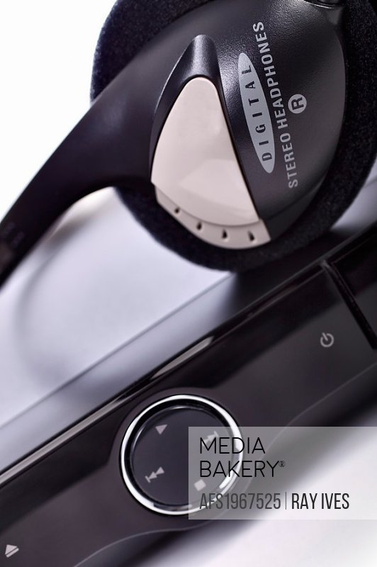Close-up of stereo headphones and DVD player  Foreground focus