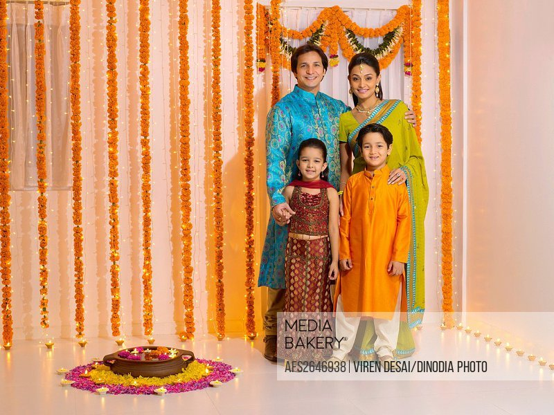 Parent with children in traditional wearing MR779P , MR779Q , MR779R , MR779S