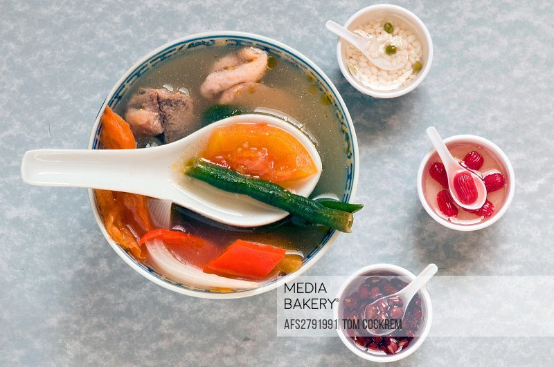 novelty shot of Chinese soup bowl with miniatures