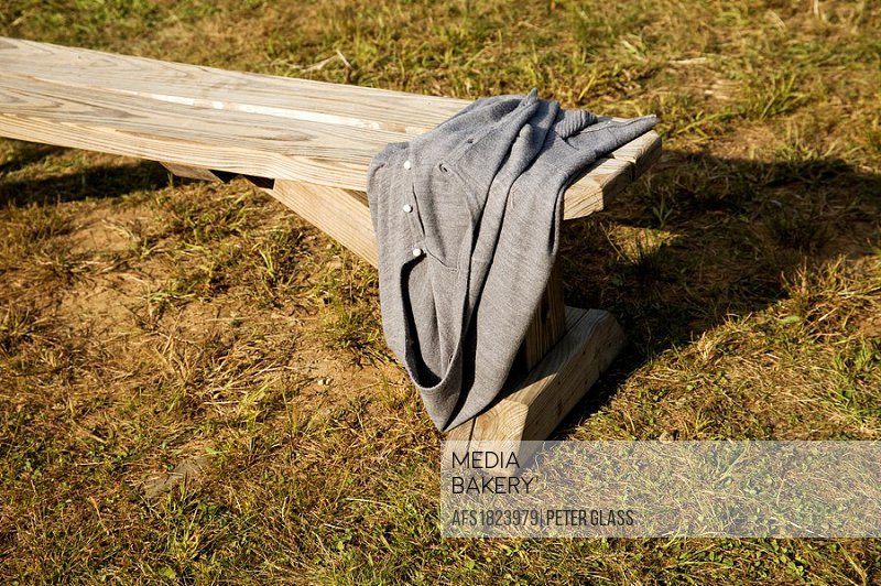 Sweater on a wooden bench