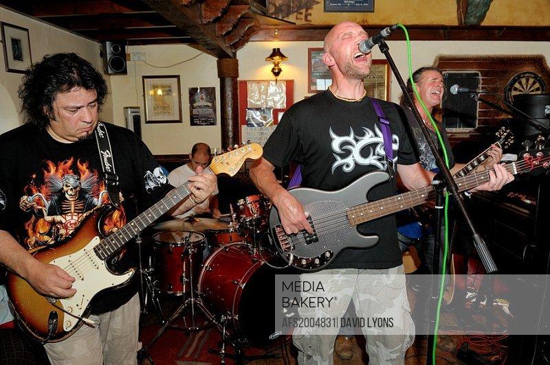 Karac, rock blues 4 piece band performing in the Sailors Return pub during Maryport Blues Festival, 2010  Cumbria, England
