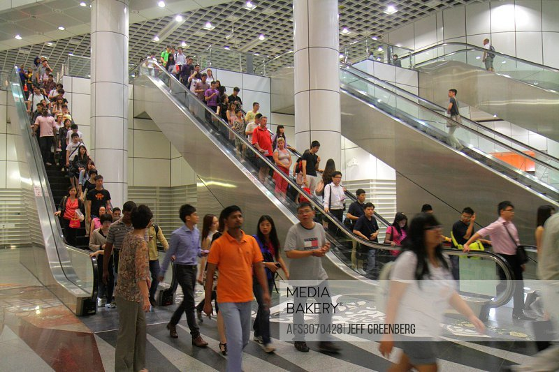 Singapore, Dhoby Ghaut MRT Station, subway train, public transportation, escalator, commuters, riders, Asian, man, woman,