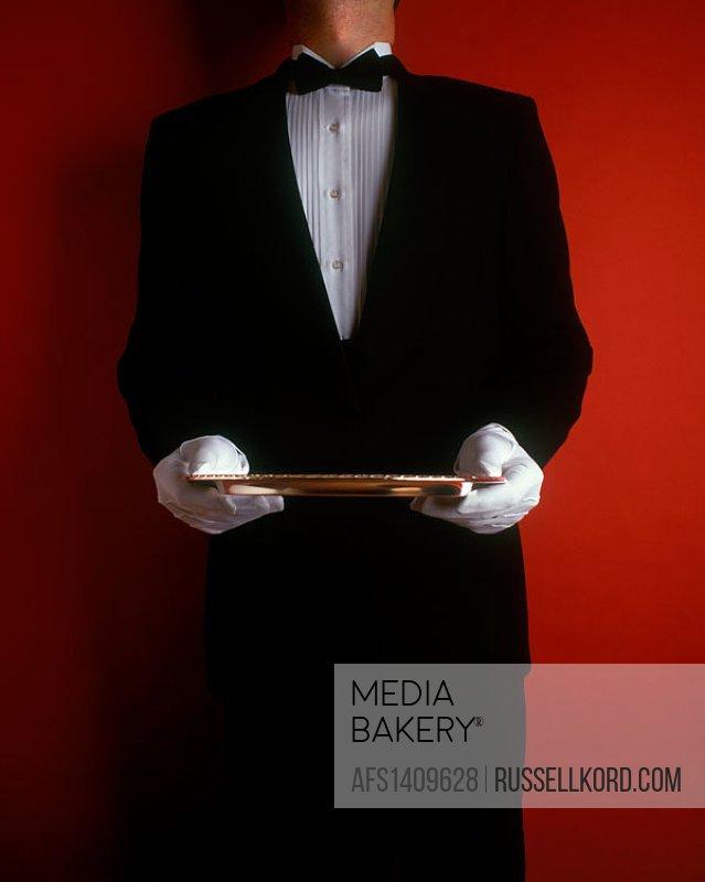 Waiter Standing Holding Silver Platter.