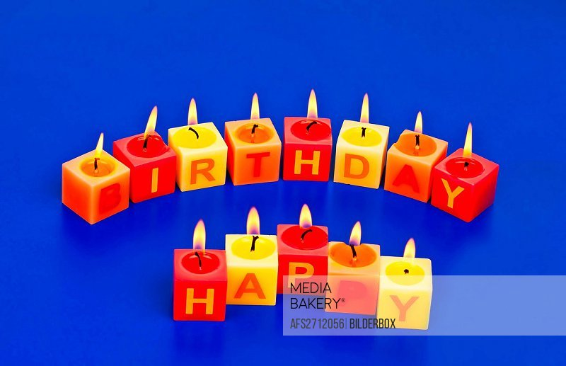 candles with writing Happy Birthday at a birthday celebration
