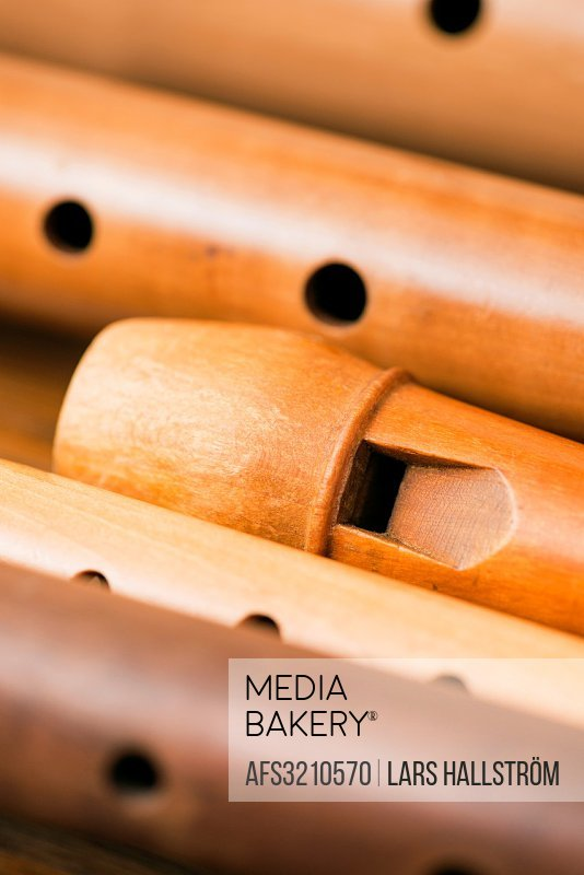 Closeup of a variety of wooden flutes.