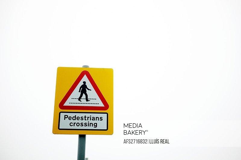 Pedestrians crossing, urban symbolism