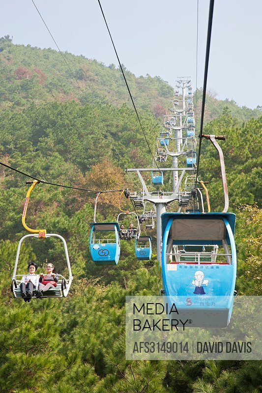 Chairlift leading to the top of Yaoshan Mountain. The highest mountain in Guilin city at 903.3 meters. Guangxi Zhuang Autonomous Region, China.