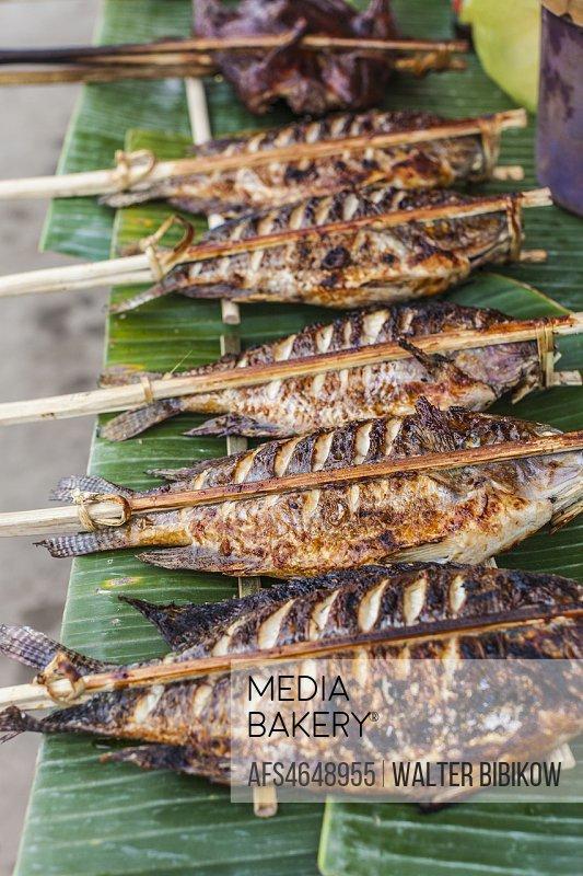 Laos, Luang Prabang, morning market, grilled fish.