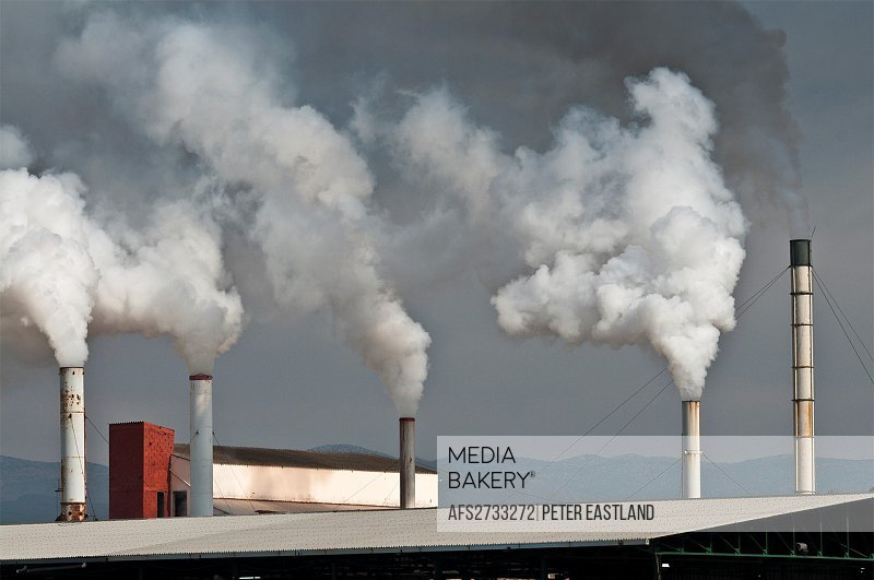 Smoking factory chimneys at Nafplio, Argolid, Peloponnese, Greece