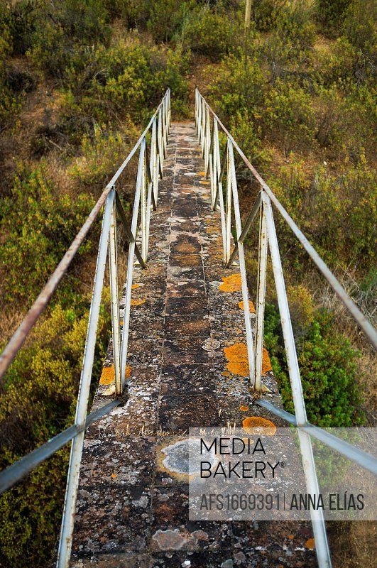 walkway with iron railings access to Mount, Alentejo, Portugal