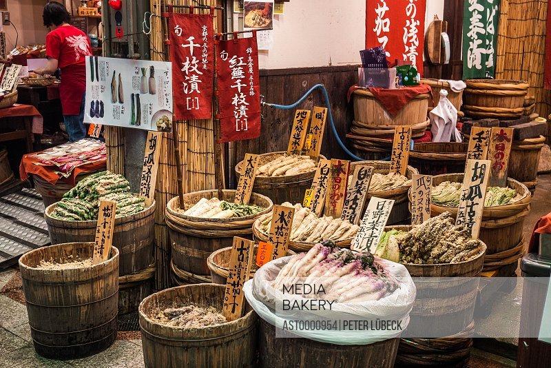 Groceries in barrels in shopping arcade street in downtown Kyoto Japan