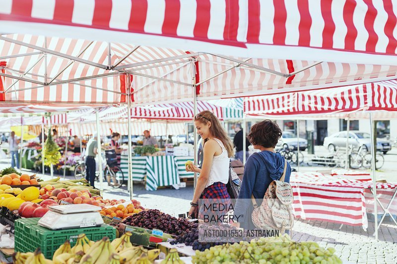 Girls shopping fruits in market