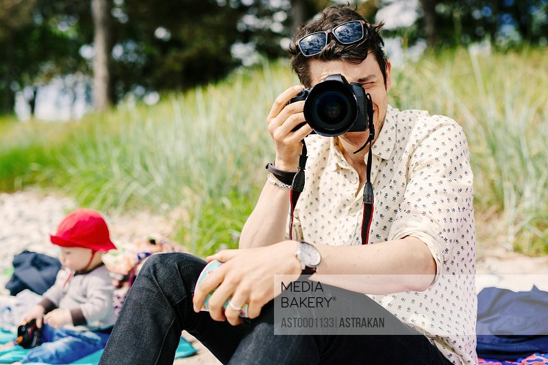 Man photographing using SLR camera