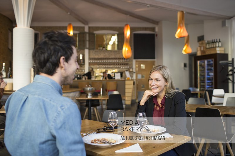 Male and female business colleagues having discussion during business meeting