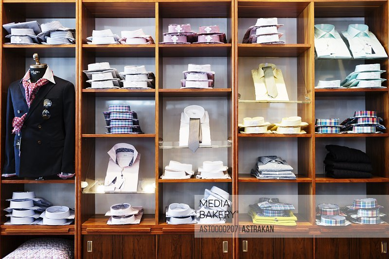 Folded shirts arranged in shelves at clothing showroom