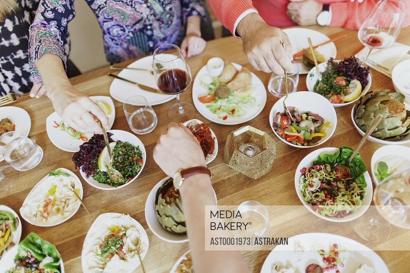 High angle view of friends having meze at table in Lebanese restaurant
