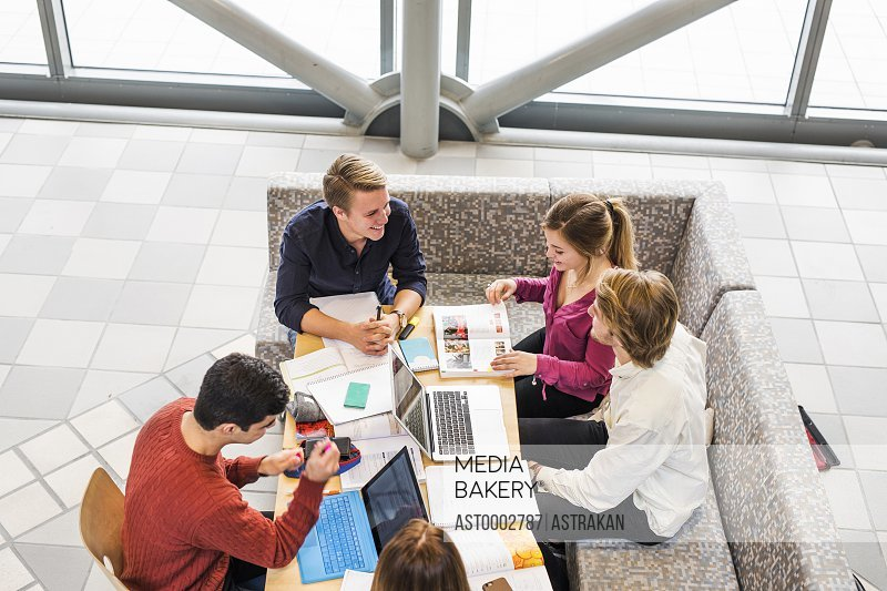 High angle view of university students studying together at table