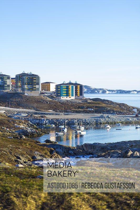 Buildings at seaside against clear sky