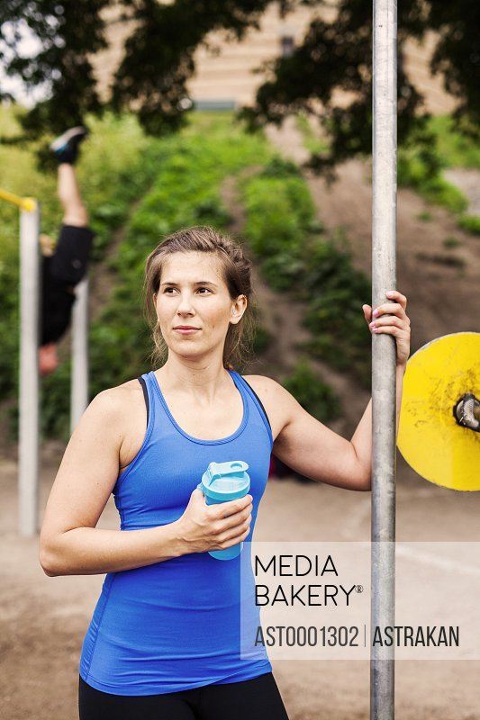 Young woman in sportswear at outdoor gym