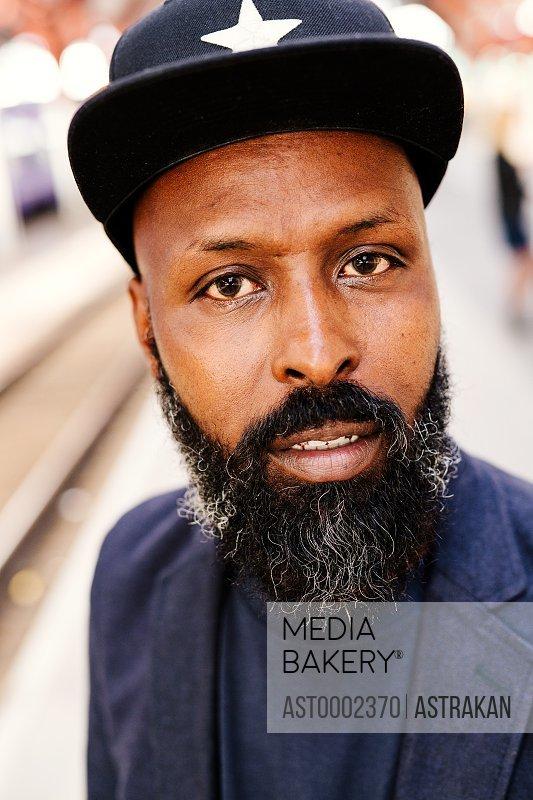Portrait of confident businessman at railroad station
