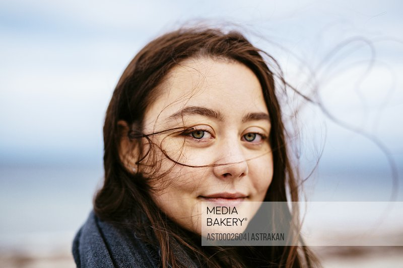 Close-up portrait of beautiful woman on beach