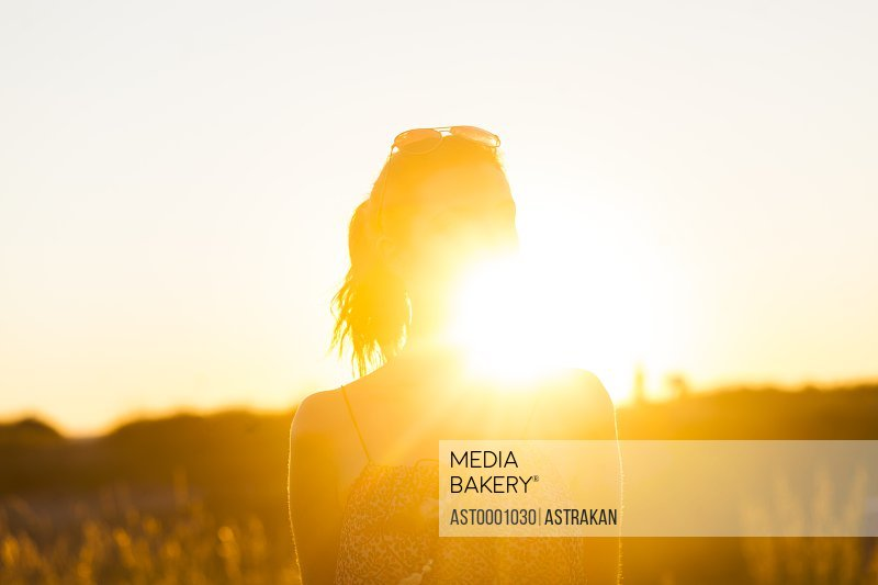 Silhouette of young woman during sunset