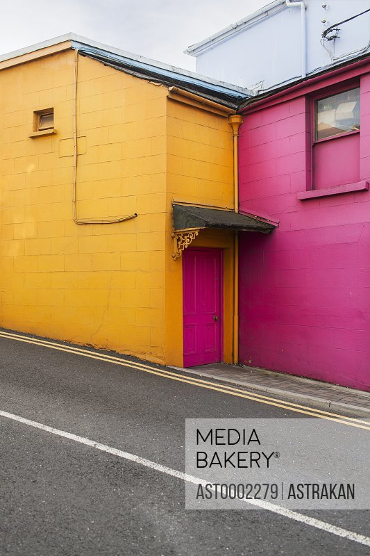Exterior of colorful building by street