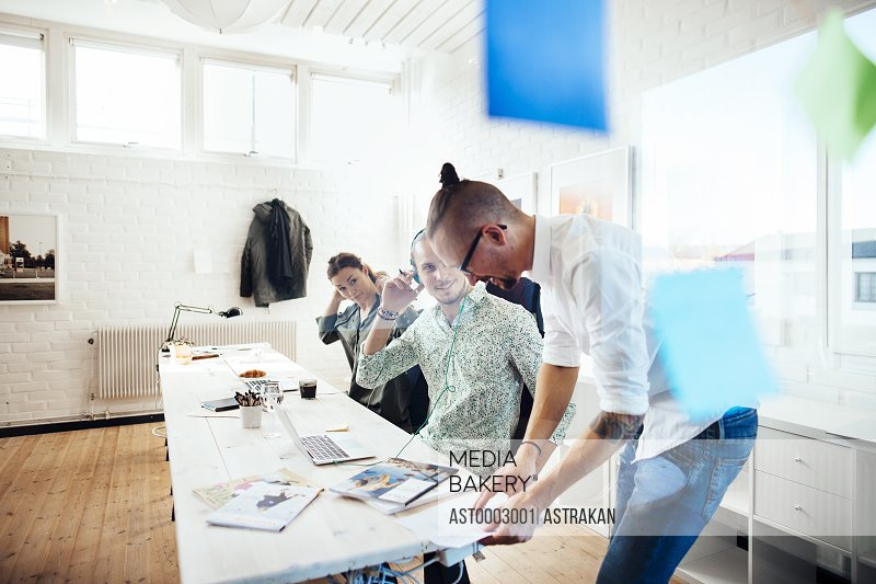Team of business people working at table in creative office