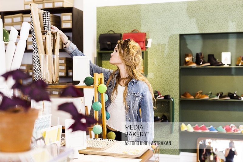 Young woman buying home decor in store