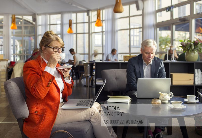 Businesswoman having coffee during business meeting